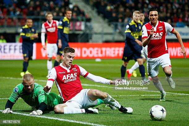 Markus Henriksen of AZ and goalkeeper Leonard Nienhuis of Cambuur battle for the ball during the Dutch Eredivisie match between AZ Alkmaar and SC...