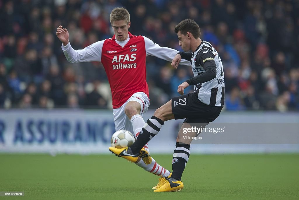 Markus Henriksen of AZ, Daryl van Mieghem of Heracles Almelo during the Dutch Eredivisie match between Heracles Almelo and AZ Alkmaar at the Polman Stadium on march 31, 2013 in Almelo, The Netherlands