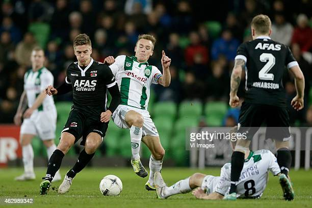 Markus Henriksen of AZ Maikel Kieftenbeld of FC Groningen during the Dutch Eredivisie match between FC Groningen and AZ Alkmaar at Euroborg on...
