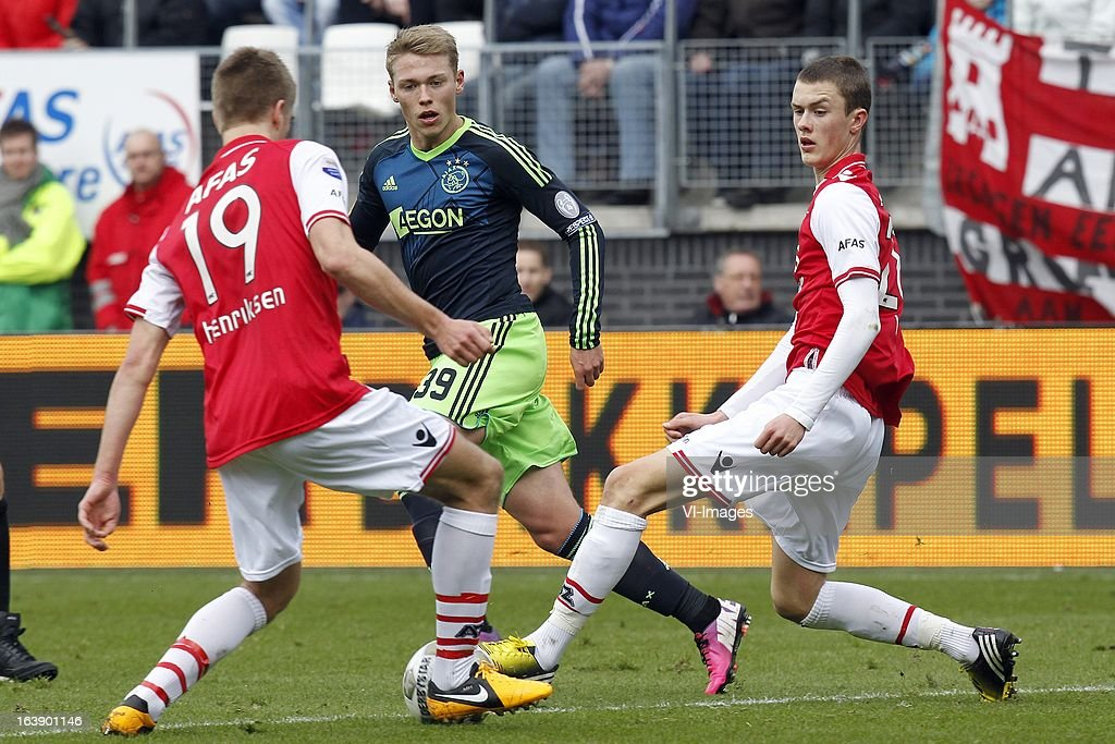 Markus Henriksen of AZ (L), Viktor Fischer of Ajax (C), Thomas Lam of AZ (R) during the Dutch Eredivisie match between AZ Alkmaar and Ajax Amsterdam at the AFAS Stadium on march 17, 2013 in Alkmaar, The Netherlands