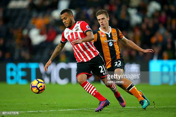 Markus Henriksen of Hull City chases down Ryan Bertrand of Southampton during the Premier League match between Hull City and Southampton at KC...