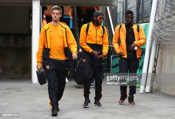 Markus Henriksen of Hull City Dieumerci Mbokani of Hull City and Moses Odubajo of Hull City arrive at the stadium prior to the Premier League match...