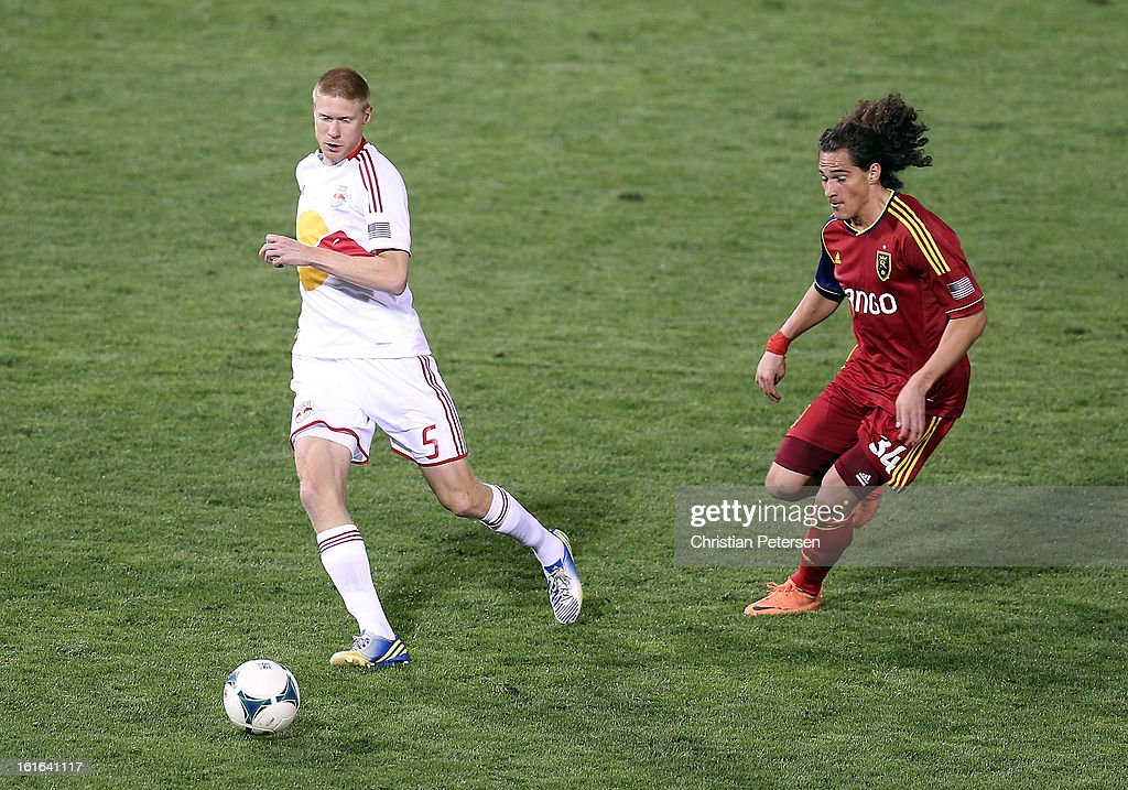 Markus Holgersson #5 of the New York Red Bulls passes the ball pressured by Devon Sandoval #34 of Real Salt Lake during the first half of the FC Tucson Desert Diamond Cup at Kino Sports Complex on February 13, 2013 in Tucson, Arizona.