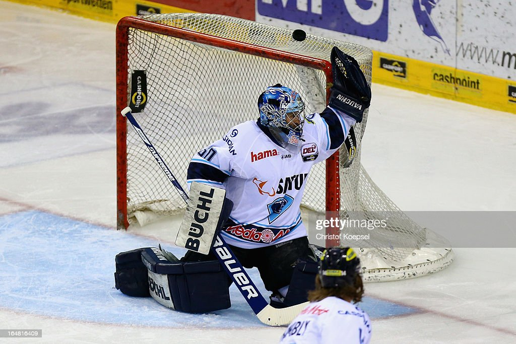 Markus Janka of ERC Ingolstadt saves the puck during the fifth DEL Play-Off-match between Krefeld Pinguine and ERC Ingolstadt at Koenigspalast on March 28, 2013 in Wuppertal, Germany.