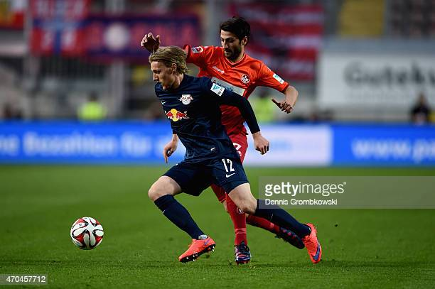 Markus Karl of 1 FC Kaiserslautern challenges Emil Forsberg of RB Leipzig during the Second Bundesliga match between 1 FC Kaiserslautern and RB...