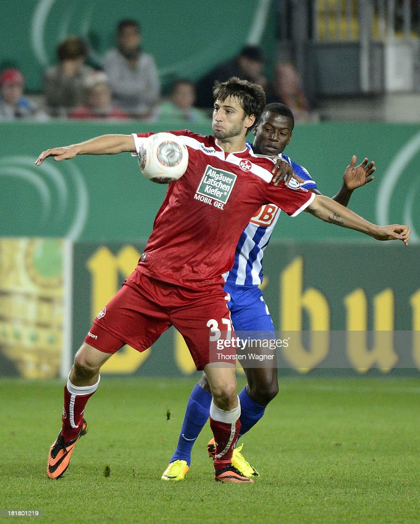 Markus Karl (L) of Kaiserslautern battles for the ball with <a gi-track='captionPersonalityLinkClicked' href=/galleries/search?phrase=Adrian+Ramos&family=editorial&specificpeople=5547196 ng-click='$event.stopPropagation()'>Adrian Ramos</a> (R) of Berlin during the DFB Cup 2nd round match between 1.FC Kaiserslautern and Hertha BSC Berlin at Fritz-Walter-Stadion on September 25, 2013 in Kaiserslautern, Germany.