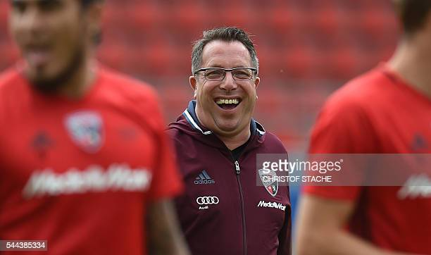 Markus Kauczinski new headcoach of the German first division Bundesliga team FC Ingolstadt 04 laughs behind players during a team trainings session...