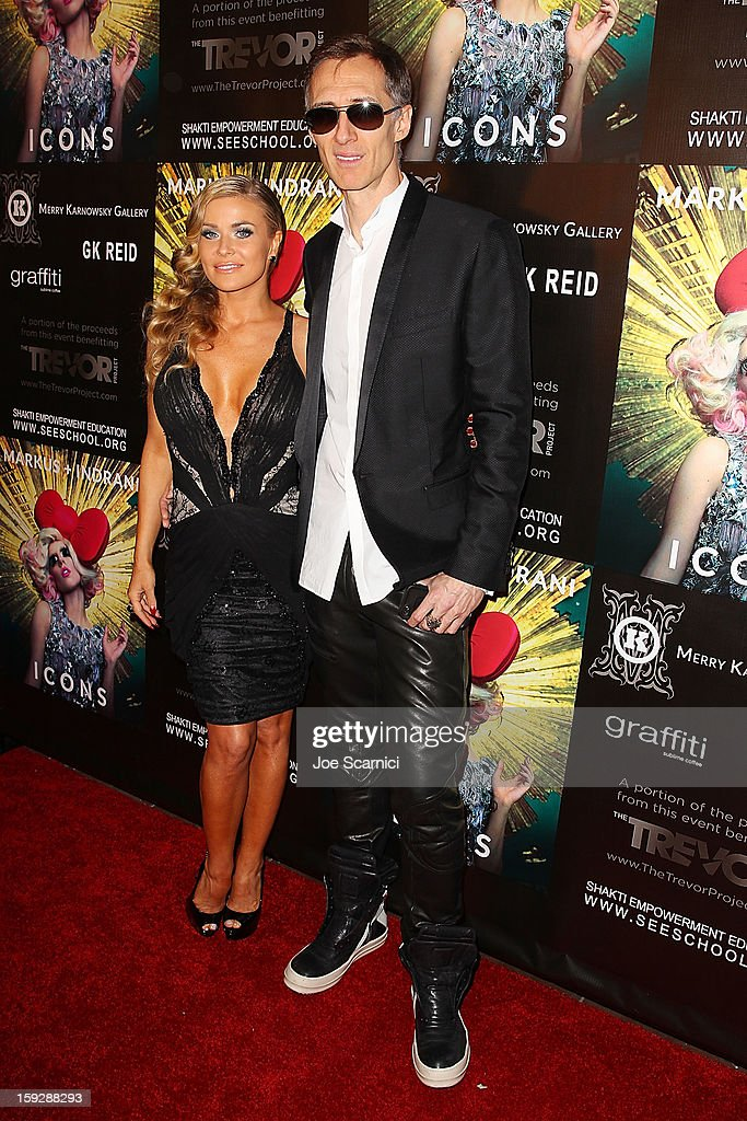 Markus Klinko and Carmen Electra arrive at Markus + Indrani Icons book launch party hosted by Carmen Electra benefiting The Trevor Project at Merry Karnowsky Gallery & Graffiti on January 10, 2013 in Los Angeles, California.