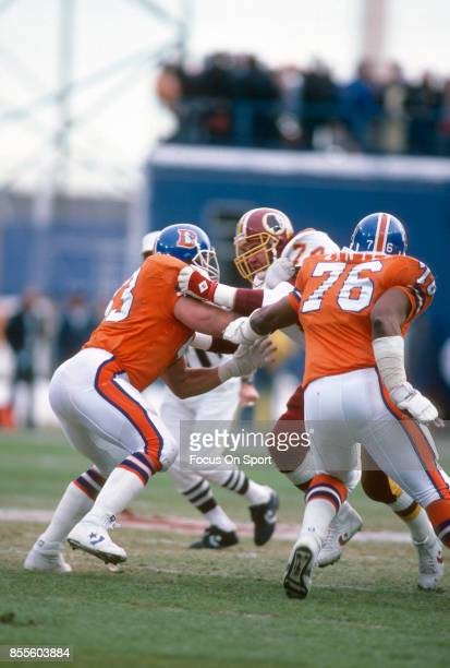 Markus Koch of the Washington Redskins in action against Ken Lanier and Mark Cooper of the Denver Broncos during an NFL football game December 13...