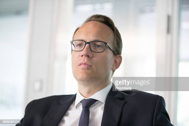 Markus Krebber chief financial officer of RWE AG pauses during an interview at the company's offices in Essen Germany on Wednesday Aug 16 2017 RWE...