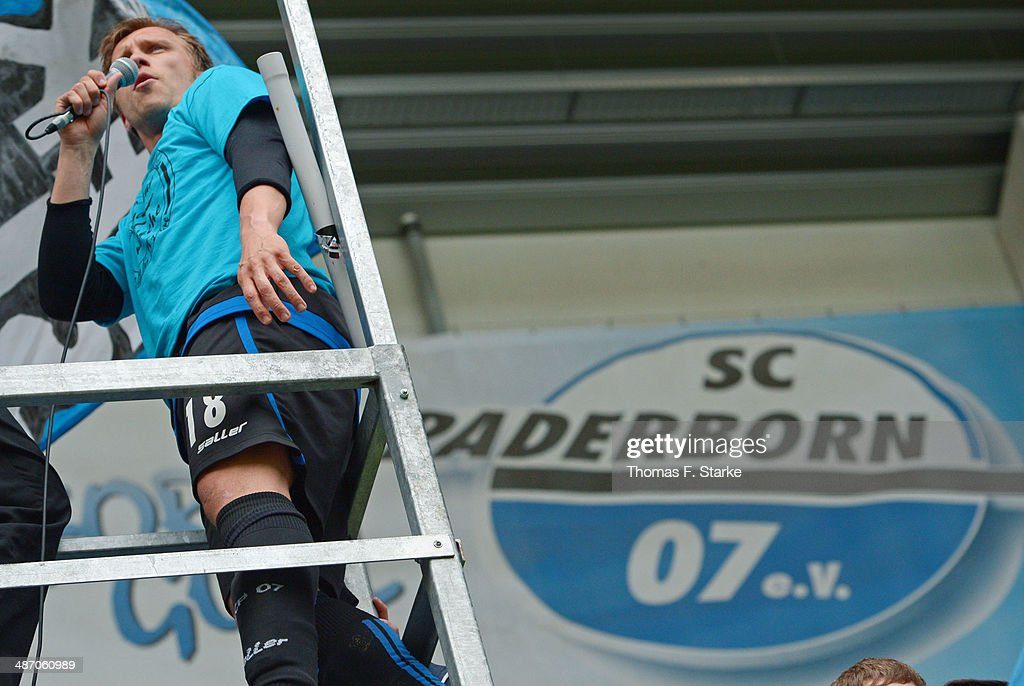 Markus Kroesche (L) celebrates with the supporters after winning the Second Bundesliga match between SC Paderborn and SV Sandhausen at Benteler Arena on April 27, 2014 in Paderborn, Germany.