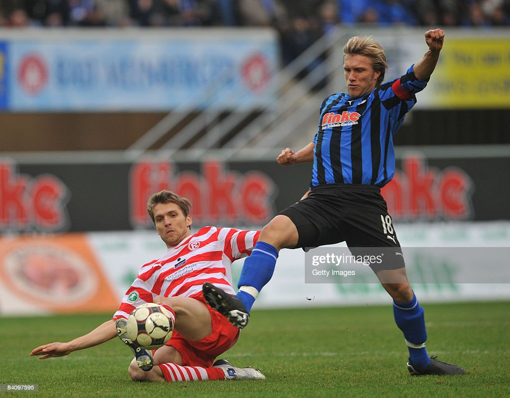 Markus Kroesche of Paderborn fights for the ball with Ranisav Jovanovic of Duesseldorf during the 3 Liga match between SC Paderborn and Fortuna...