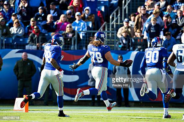 Markus Kuhn of the New York Giants returns a fumble for a touchdown during a game against the Tennessee Titans at LP Field on December 7 2014 in...