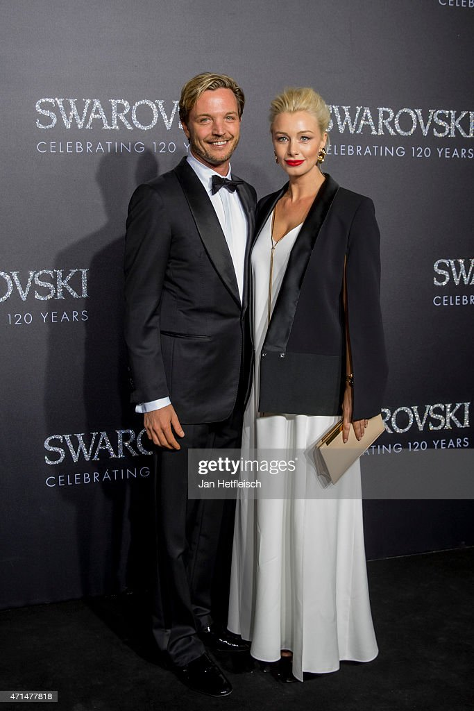 Markus Langes Swarovski and his wive Julia pose for a picture on the 'black' carpet of the grand reopening of the Swarovski Crystal Worlds on April...
