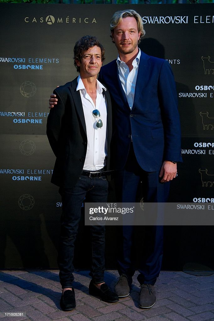 Markus Langes-Swarovski (R) and Willie Marquez (L) attend Swarovski-Osborne Bull illumination at the Casa America on June 25, 2013 in Madrid, Spain.