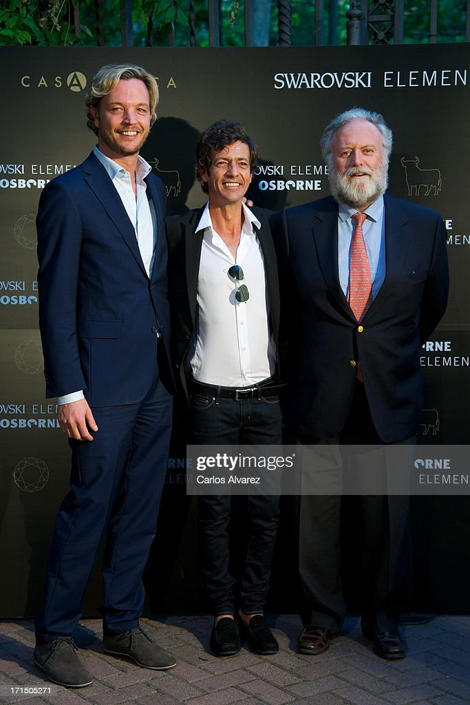 Markus Langes-Swarovski, Willie Marquez and Tomas Osborne attend Swarovski-Osborne Bull illumination at the Casa America on June 25, 2013 in Madrid, Spain.