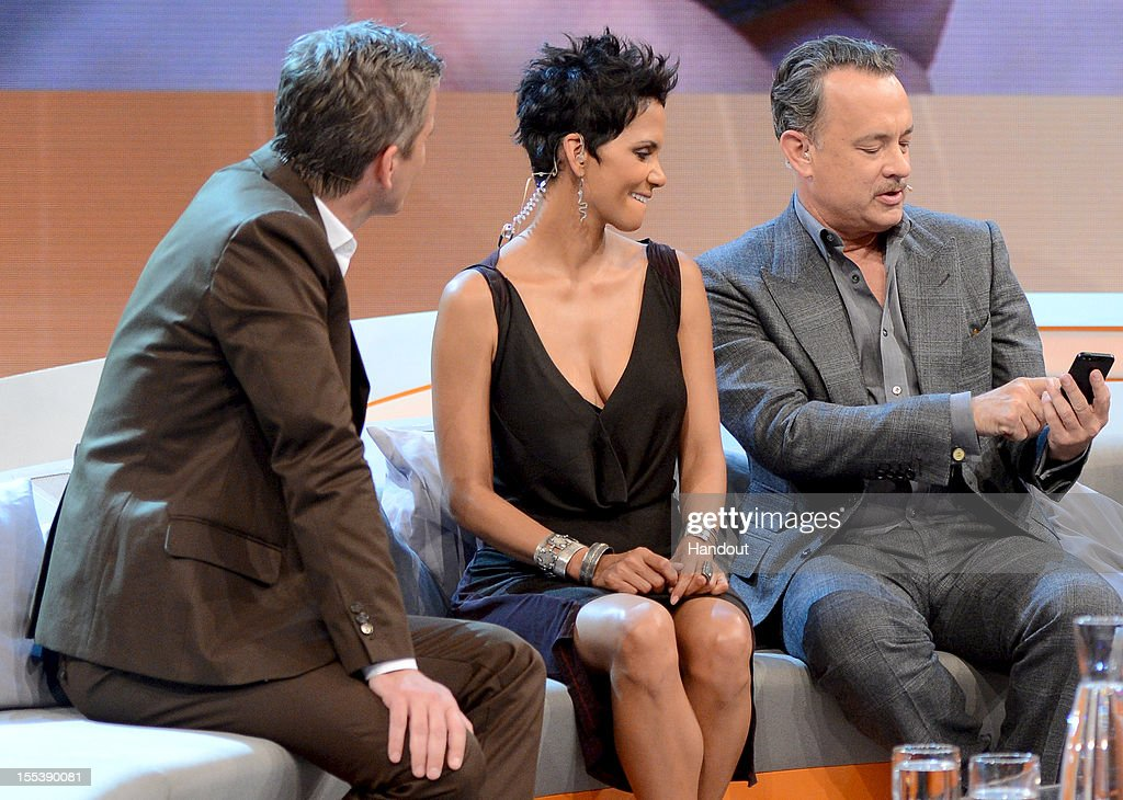 Markus Lanz welcomes Tom Hanks and Halle Berry react during the 'Wetten dass' show on November 3 2012 in Bremen Germany