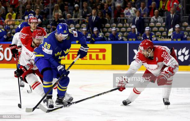 Markus Lauridsen of Denmark challenges William Nylander of Sweden for the puck during the 2017 IIHF Ice Hockey World Championship game between...