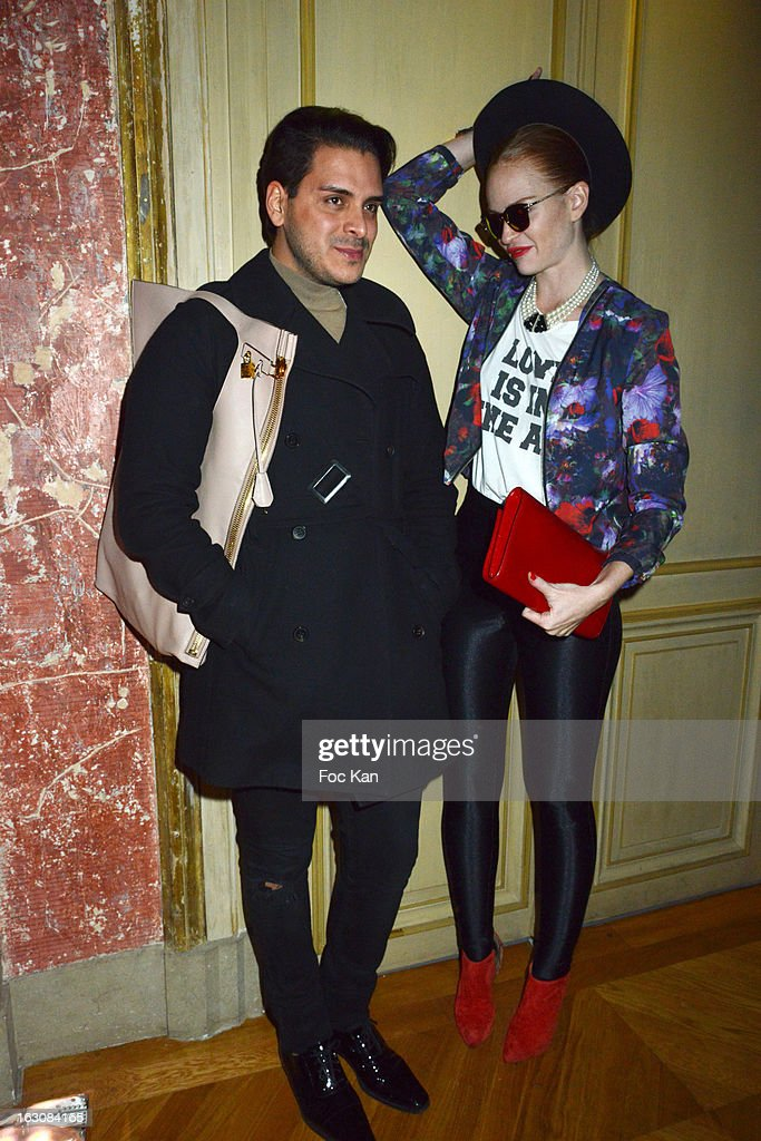 Markus Molinari and Miss Crazy Rouge attend the Diesel and Edun Party - PFW F/W 2013 at La Gaite Lyrique on March 3rd, 2013 in Paris, France.