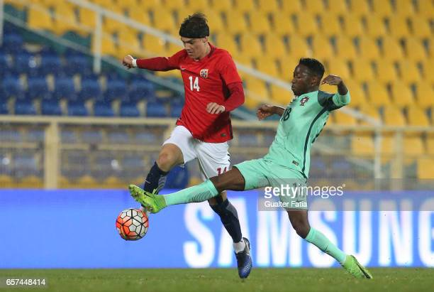 Markus Nakkim of Norway with Portugal forward Carlos Mane in action during the U21 International Friendly match between Portugal and Norway at...