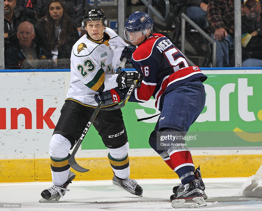 Markus Niemelainen #56 of the Saginaw Spirit battles against Brady Pataki #23 of the London Knights during an OHL game at Budweiser Gardens on October 21, 2016 in London, Ontario, Canada. The Knights defeated the Spirit 5-1.