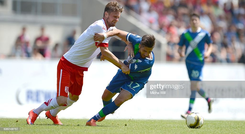Markus Palionis (L) of Regensburg challenges Hilal El-Helwe of Wolfsburg during the Third League play off second leg match between Jahn Regensburg and VfL Wolfsburg II at Continental Arena on May 29, 2016 in Regensburg, Germany.