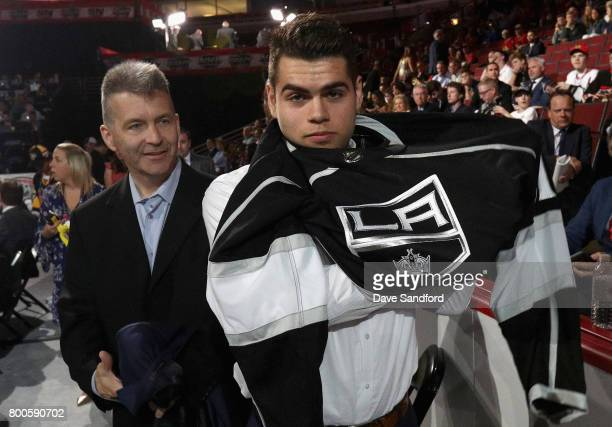 Markus Phillips puts on his jersey after being selected 118th overall by the Los Angeles Kings during the 2017 NHL Draft at United Center on June 24...