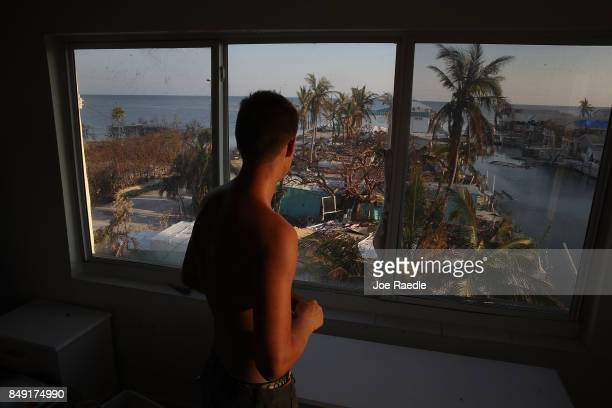 Markus Reinfandt looks out the third story window of his home onto the mobile homes that were destroyed by hurricane Irma on September 18 2017 in...