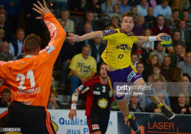 Markus Richwien of Berlin scores against Dario Quenstedt of Luebbecke during the Toyota Handball Bundesliga match between TuS NLuebbecke and Fuechse...