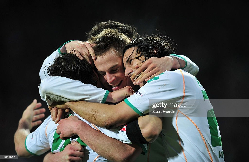 Markus Rosenberg of Bremen celebrates with Claudio Pizarro (R) and Diego (L) after scoring his team's third goal during the Bundesliga match between Werder Bremen and VfB Stuttgart at the Weser Stadium on March 15, 2009 in Bremen, Germany.