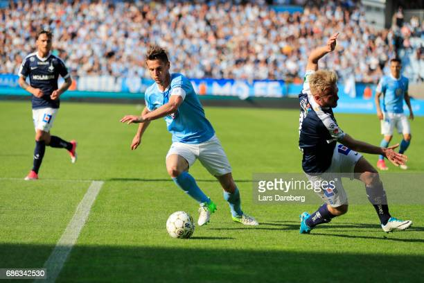 Markus Rosenberg of Malmo FF and Nicklas Barkroth of IFK Norrkoping during the Allsvenskan match between Malmo FF and IFK Norrkoping at Swedbank...