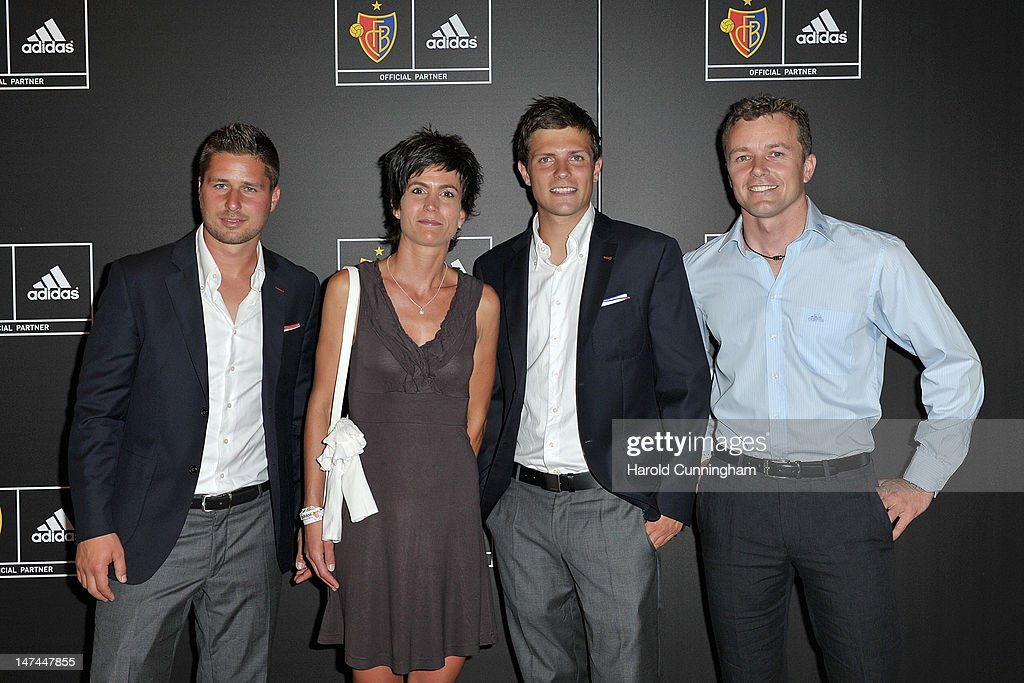 <a gi-track='captionPersonalityLinkClicked' href=/galleries/search?phrase=Markus+Steinhoefer&family=editorial&specificpeople=2131716 ng-click='$event.stopPropagation()'>Markus Steinhoefer</a> of FC Basel, Isabel Faessler, <a gi-track='captionPersonalityLinkClicked' href=/galleries/search?phrase=Valentin+Stocker&family=editorial&specificpeople=5522265 ng-click='$event.stopPropagation()'>Valentin Stocker</a> of FC Basel and Marcel Faessler pose during the adidas new FC Basel kit presentation at Novartis on June 29, 2012 in Basel, Switzerland.