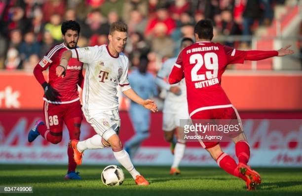 Markus Suttner and Almog Cohen of Ingolstadt and Joshua Kimmich of Munich vie for the ball during the Bundesliga soccer match between FC Ingolstadt...