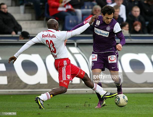 Markus Suttner of Austria Wien is tackled by Ibrahim Sekagya of Salzburg during the tipp3Bundesliga powered by TMobile match between FC Red Bull...