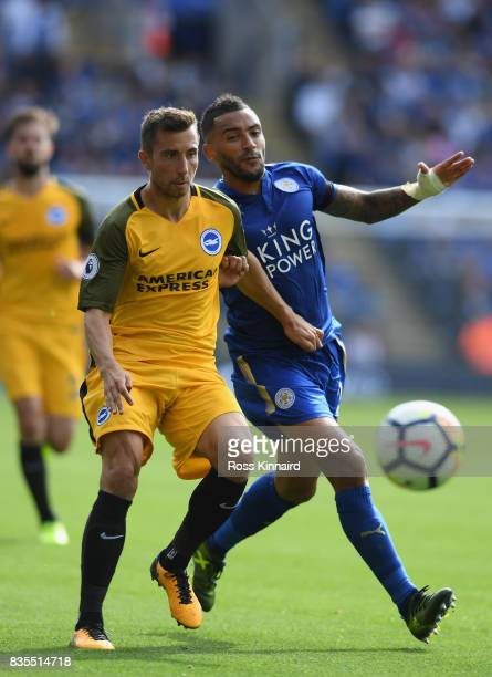 Markus Suttner of Brighton and Hove Albion and Danny Simpson of Leiceter City battle for possession during the Premier League match between Leicester...