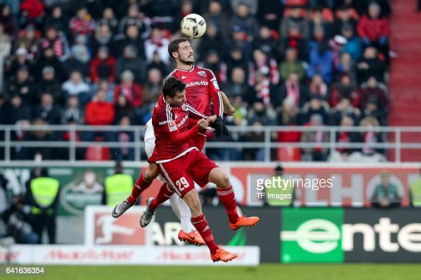 Markus Suttner of FC Ingolstadt Mathew Leckte of FC Ingolstadt and Joshua Kimmich of Bayern Muenchen battle for the ball during the Bundesliga match...