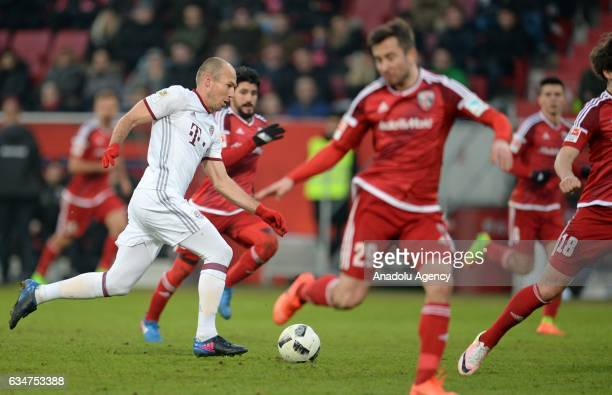 Markus Suttner of Ingolstadt and Arjen Robben of Munich vie for the ball during the Bundesliga soccer match between FC Ingolstadt and FC Bayern...