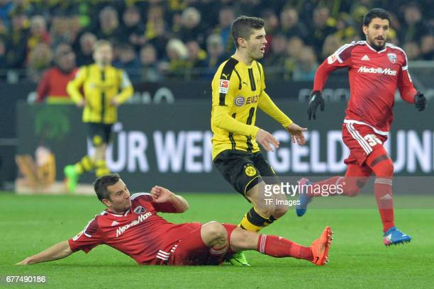 Markus Suttner of Ingolstadt and Christian Pulisic of Dortmund battle for the ball during the Bundesliga match between Borussia Dortmund and FC...