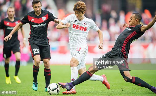 Markus Suttner of Ingolstadt Yuya Osako of Koeln and Marcel Tisserand of Ingolstadt in action during the Bundesliga match between 1 FC Koeln and FC...