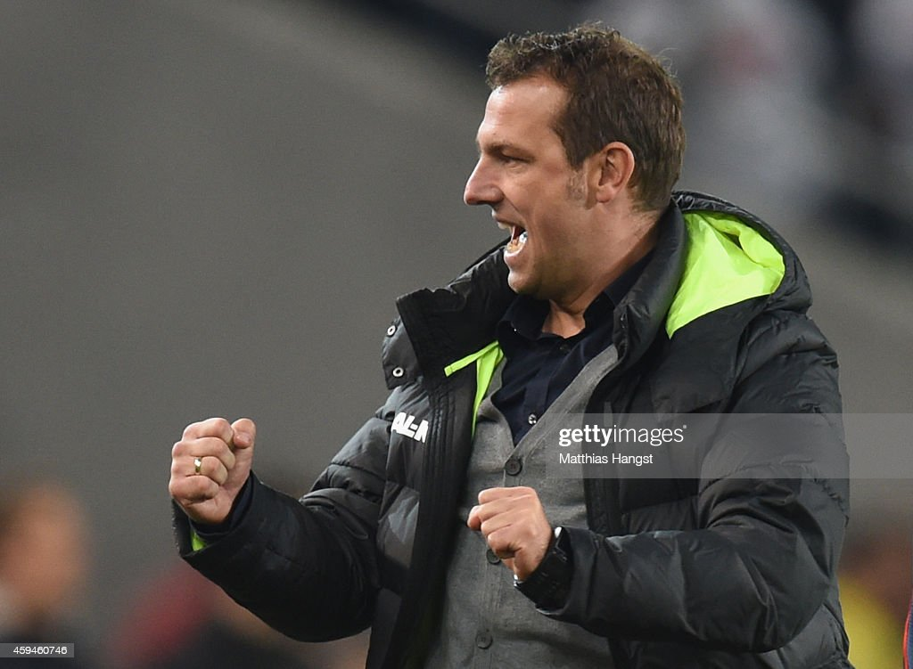 <a gi-track='captionPersonalityLinkClicked' href=/galleries/search?phrase=Markus+Weinzierl&family=editorial&specificpeople=5848121 ng-click='$event.stopPropagation()'>Markus Weinzierl</a>, head coach of Augsburg celebrates during the Bundesliga match between VfB Stuttgart and FC Augsburg at Mercedes-Benz Arena on November 23, 2014 in Stuttgart, Germany.