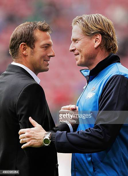 Markus Weinzierl head coach of Augsburg chats to Markus Gisdol head coach of Hoffenheim before the Bundesliga match between FC Augsburg and 1899...
