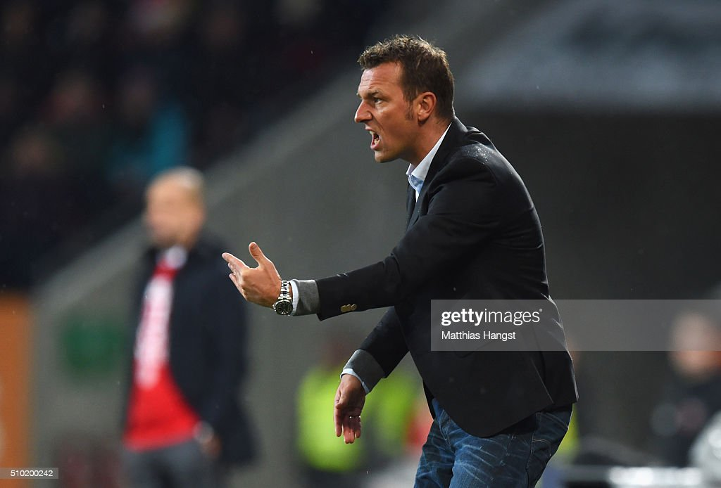 <a gi-track='captionPersonalityLinkClicked' href=/galleries/search?phrase=Markus+Weinzierl&family=editorial&specificpeople=5848121 ng-click='$event.stopPropagation()'>Markus Weinzierl</a> head coach of Augsburg gives instructions during the Bundesliga match between FC Augsburg and FC Bayern Muenchen at SGL Arena on February 14, 2016 in Augsburg, Germany.