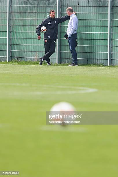 Markus Weinzierl head coach of Augsburg looks on with Stefan Reuter Sporting director of Augsburg after a FC Augsburg Training session at WWK Arena...