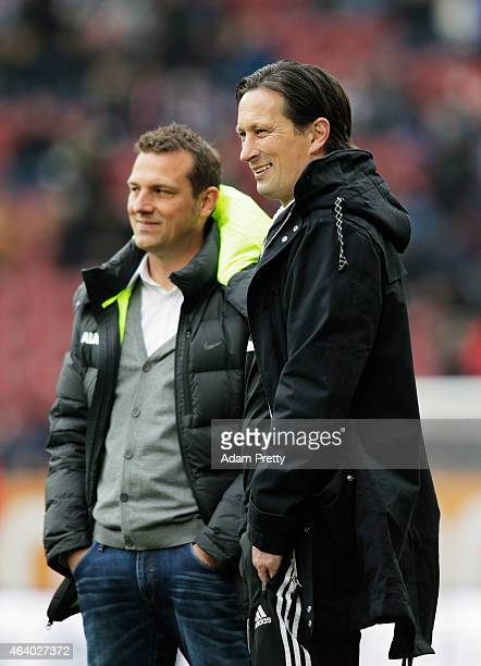 Markus Weinzierl Head Coach of FC Augsburg chats to Roger Schmidt Head Coach of Bayer Leverkusen before the Bundesliga match between FC Augsburg and...