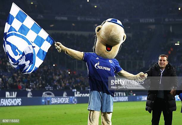 Markus Weinzierl head coach of FC Schalke 04 celebrates with the team mascot after victory in the Bundesliga match between FC Schalke 04 and SV...