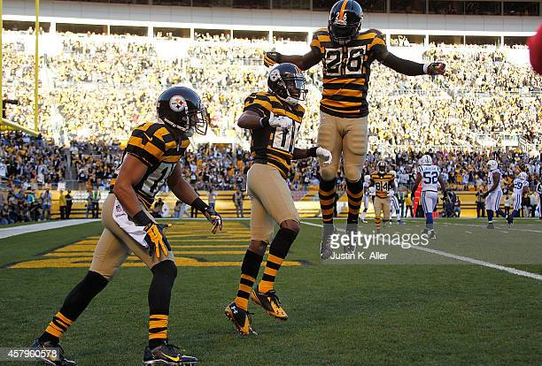 Markus Wheaton celebrates his touchdown with Le'Veon Bell of the Pittsburgh Steelers during the first quarter against the Indianapolis Colts at Heinz...