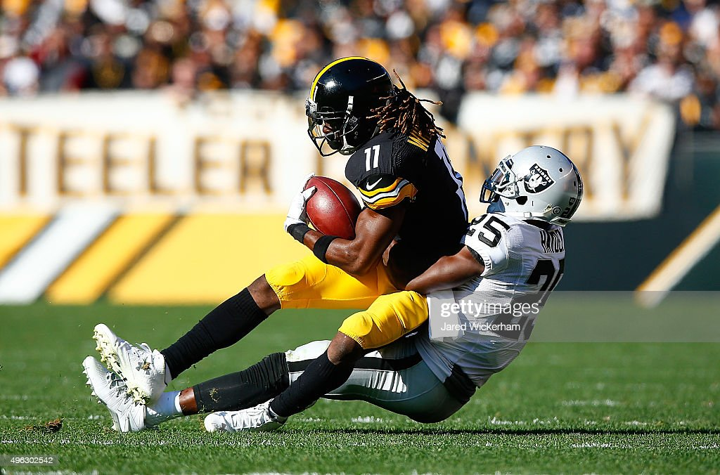 Markus Wheaton of the Pittsburgh Steelers is tackled by DJ Hayden of the Oakland Raiders during the first quarter of the game at Heinz Field on...