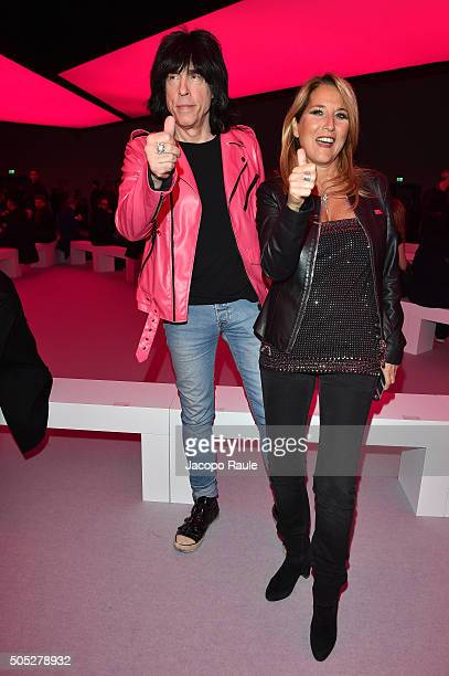 Marky Ramone and Jo Squillo attend the Versace show during Milan Men's Fashion Week Fall/Winter 2016/17 on January 16 2016 in Milan Italy