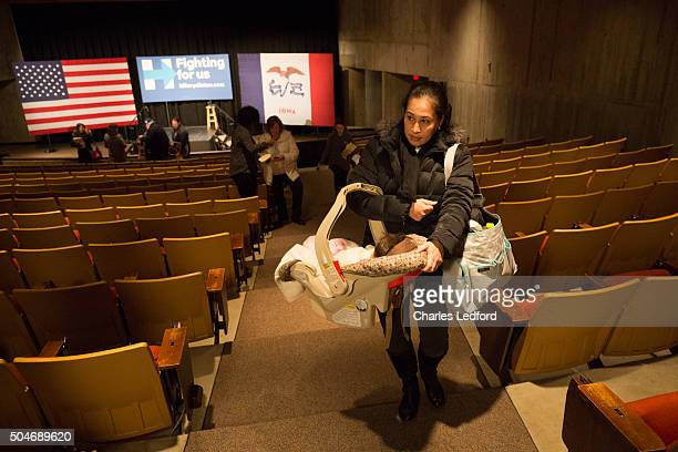 Marlí Mesa a Venezuelan citizen carries her fourmonthold daughter Amy Bauer as they leave Democratic presidential candidate former United States...