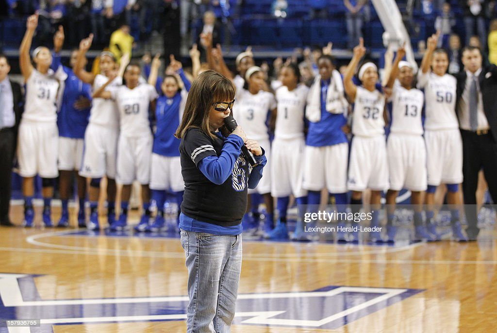 Marlana VanHoose sang 'My Old Kentucky Home,' with the Kentucky women's basketball team looking on, during UK's game against DePaul at Rupp Arena in Lexington, Kentucky, Friday, December 7, 2012. Kentucky defeated DePaul, 96-64.